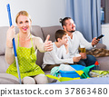 Happy mother ready to cleaning house 37863480