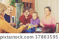 Senior women with child at desk with bingo 37863595