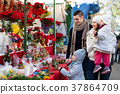 Family of four at Christmas market 37864709