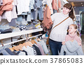 Mother and daughter choosing clothes 37865083