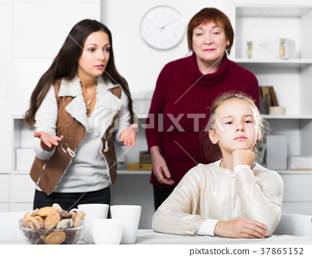 Upset girl scolded by mother and grandma 37865152