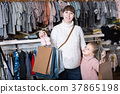 Smiling pregnant woman and girl boasting purchases 37865198