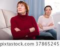 Portrait upset adult women looking away after conflict 37865245