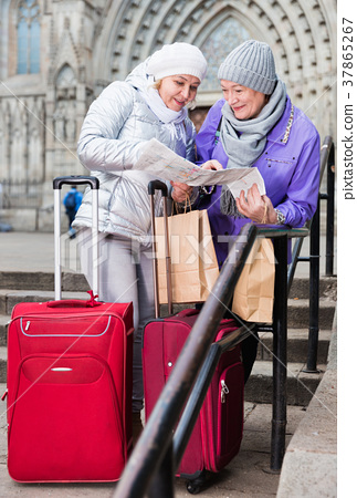 Mature ladies travellers with map 37865267