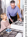Mature couple in shop choose to themselves gas stove 37865386