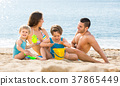 father, mother and children on the beach 37865449
