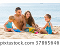 Family of four at the beach 37865646