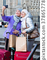 Senior females travelers taking selfie 37865778