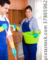 Professional cleaners at the work. 37865962