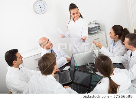 Medics at colloquium in clinic. 37866699