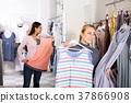 Woman choosing pajamas in lingerie shop 37866908