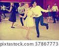 Positive couple practicing vigorous twist movements 37867773