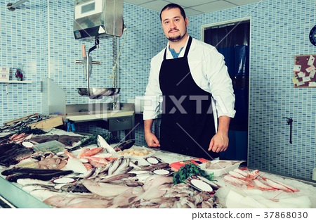 Man standing near fish 37868030