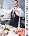 man, fish, cuttlefish 37868053