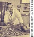 counter, man, fish 37868188