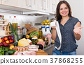 woman is checking purchases 37868255