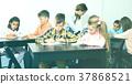 Professor and elementary age children 37868521