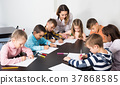 Children of elementary age having class of art 37868585