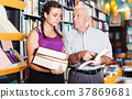 grandfather with girl are reading literature 37869681
