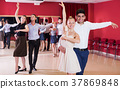 Dancing couples enjoying latin dances 37869848