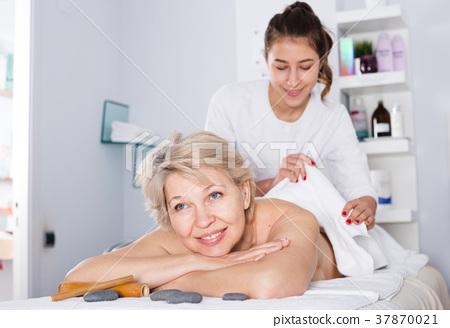 Mature woman having massage 37870021