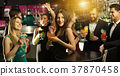 Cheerful employees dancing on corporate party 37870458