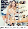 Woman choosing summer shoes 37870497