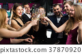 Young people are drinking sparkling wine 37870920