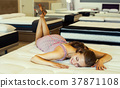 woman is lying on the mattress 37871108