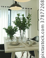 vase at center dining table with vintage pendant 37877268