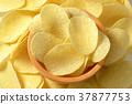 Salted potato crisps 37877753