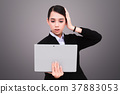 Closeup of woman with tablet 37883053