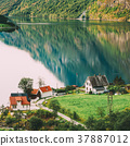 Scandinavian houses on shore of the narrowest 37887012