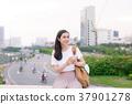 Young beautiful asian woman using smartphone 37901278
