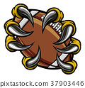 Monster animal claw holding American Football Ball 37903446