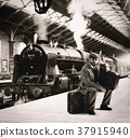 Emigrant to the train station with cardboard suitcases 37915940