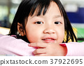 asian child girl smiling brightly with happiness. 37922695
