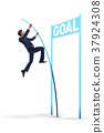 Businessman pole vaulting towards his goal in 37924308