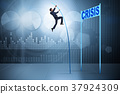 Businessman pole vaulting over crisis in business 37924309