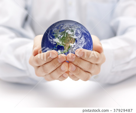Earth in hands. Earth image provided by Nasa.  37929487