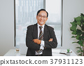 Confident senior asian business leader standing 37931123