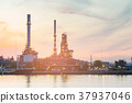 Oil factory water side with sunset tone  37937046