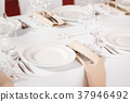 Tables set for an event party or wedding reception 37946492