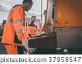 Garbage removal men working for a public utility 37958547