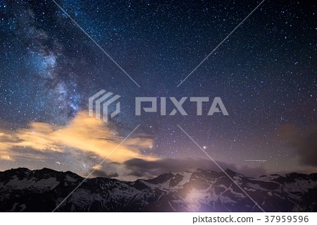 Milky Way starry sky rocky mountains. 37959596