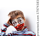little cute boy with facepaint like clown 37974383