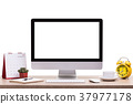 Modern desktop computer, Coffee cup, alarm clock, notebook and calendar on wooden table. Studio shot isolated on white. Blank screen for graphics display montage 37977178