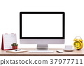 Modern desktop computer, Coffee cup, alarm clock, notebook and calendar on wooden table. Studio shot isolated on white. Blank screen for graphics display montage 37977711