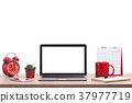 Modern laptop computer, Coffee cup, alarm clock, notebook and calendar on wooden table. Studio shot isolated on white. Blank screen for graphics display montage 37977719