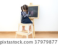 Cute little girl drawing on chalkboard at home 37979877